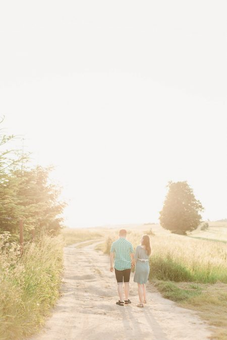 Parents to be having walk at sunset