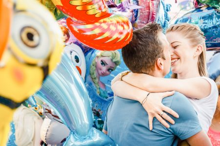 Carousel engagement photoshoot with balloons