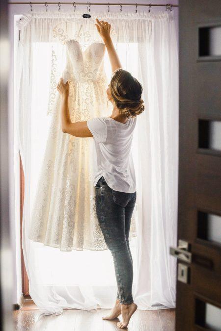 Bride holding wedding dress_wedding dress details