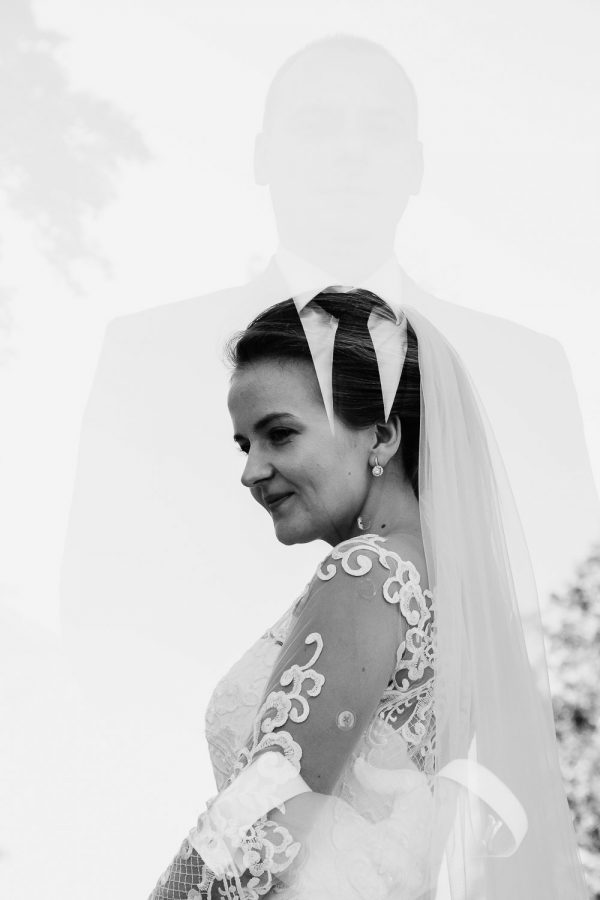 Black and white photo with double exposure with bride and groom