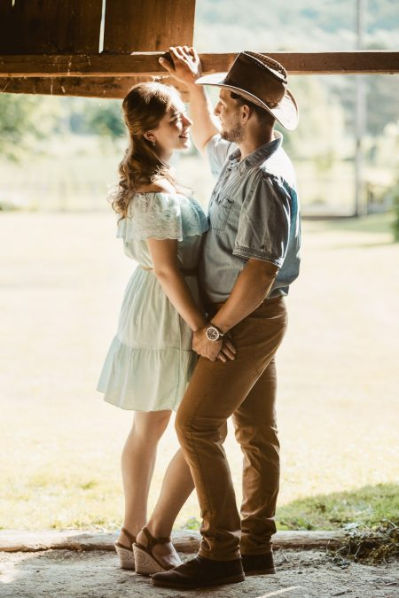 Romantic engagement photo shoot in barn