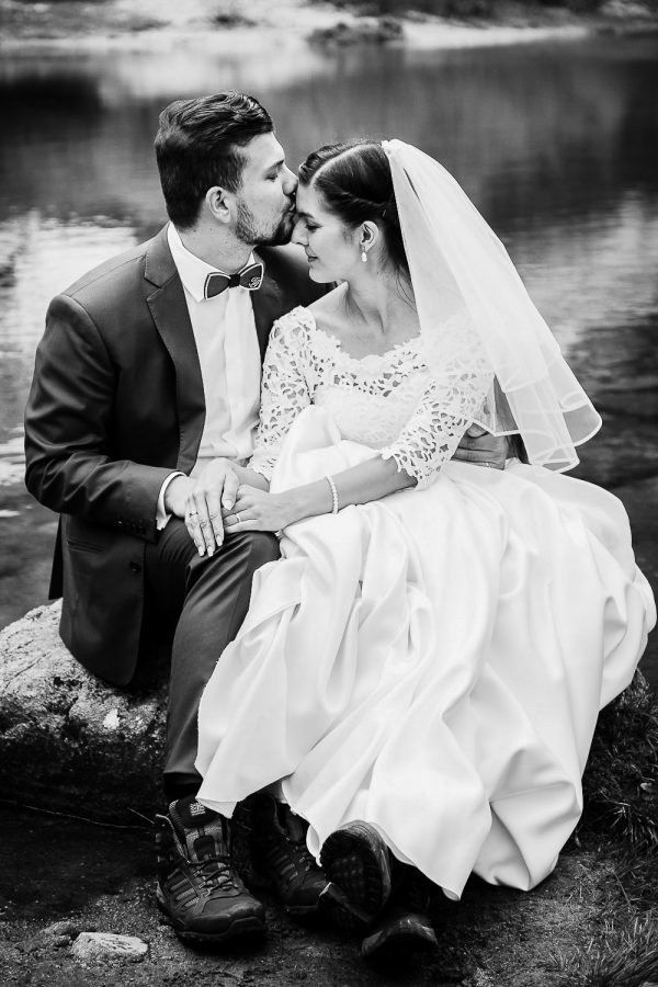 Bride and Groom sitting on a rock