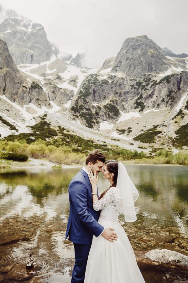 Bride and Groom by the lake destination wedding in High Tatras