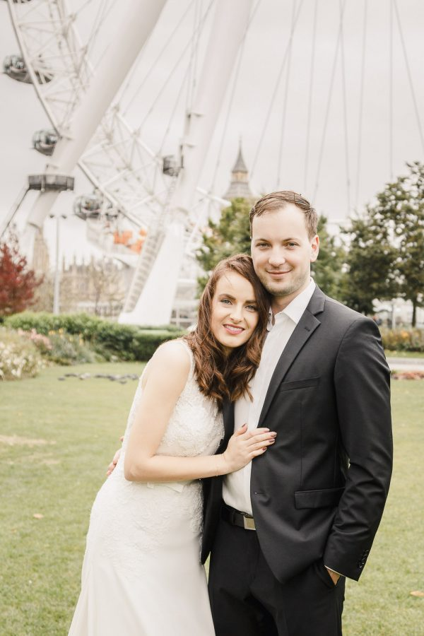 Bride with brother in front of London eye England