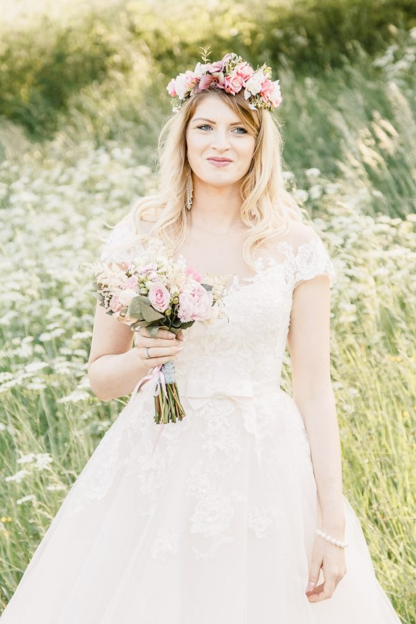 Bride with bouquet in romantic style